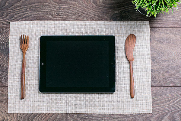 Tablet computer as a meal on the table